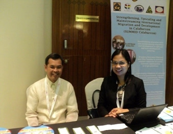 NEDA Regional Director Luis Banua together with PSR Aileen Constantino- Penas is SUMMID- CALABARZON information booth