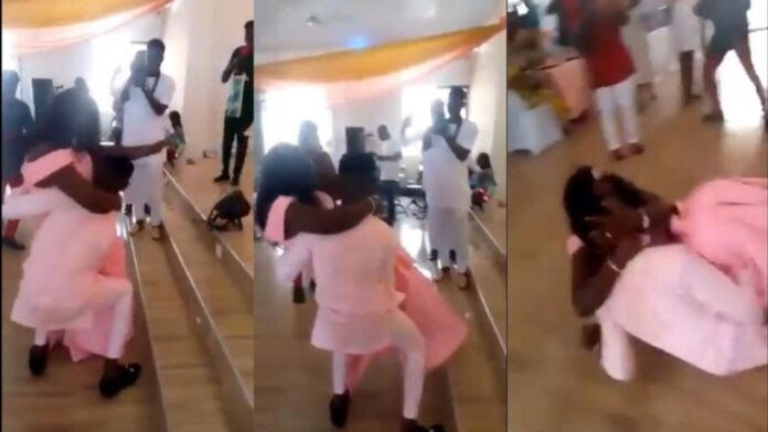 groom falls down with his over-sized wife