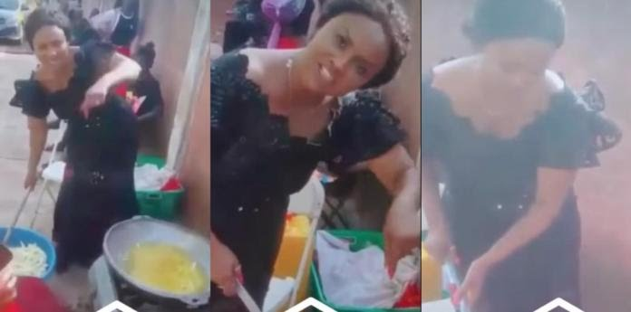 Mcbrown puts her fame down and helps cooking at a funeral in a new video