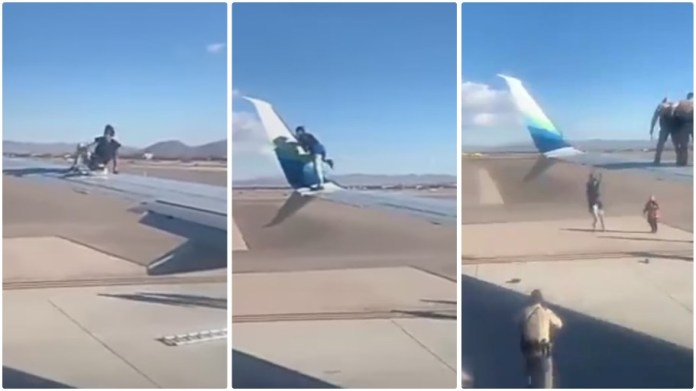 Man jumps on plane wing