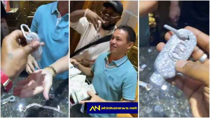 Davido flaunts diamond-studded hand sanitiser