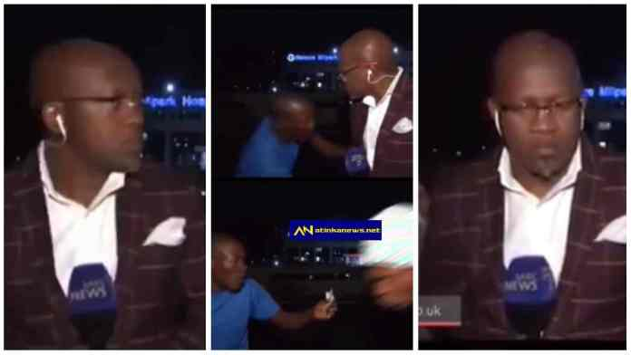 Street robbers attack and rob journalist who was reporting an event live on television