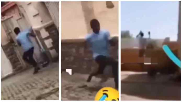 boy being chased by a dog jumped over a high fence without touching it