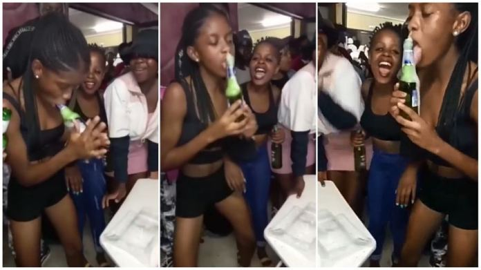 Video of young woman sucking on a beer bottle