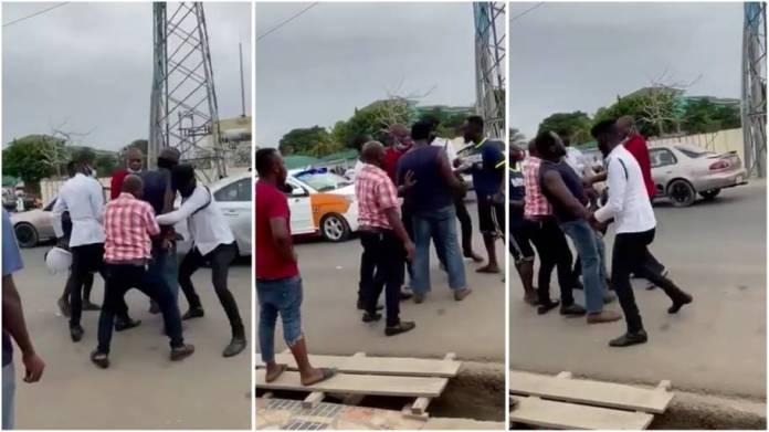 Ghana police officers struggle to arrest driver