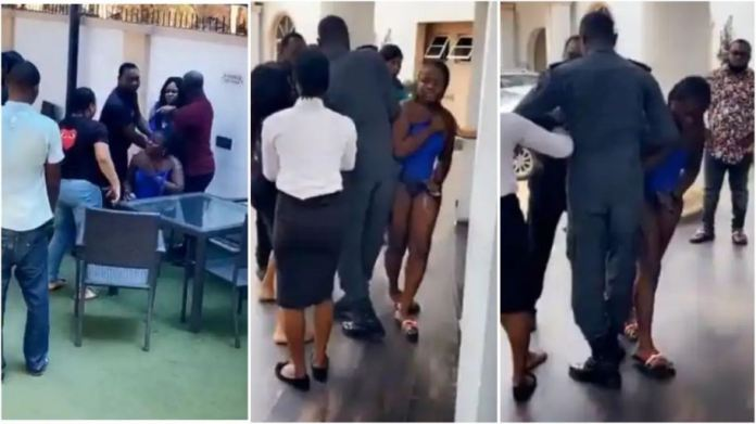 Angry wife disciplines husband's side chick after catching them in a hotel