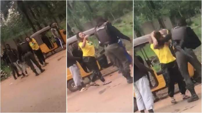 Police officer caught on camera beating young lady at checkpoint in Enugu