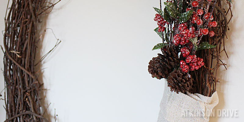 Celebrate the season on a budget with this Winter-inspired grapevine wreath! Great for Christmas, and all season long. /// by Atkinson Drive