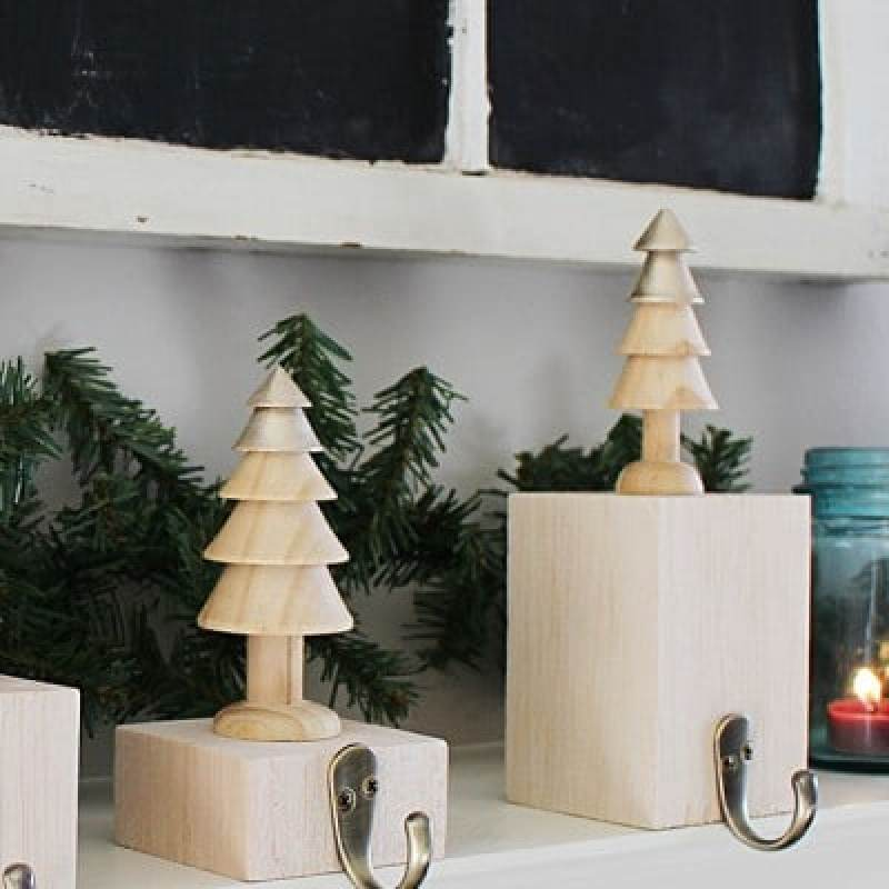 Make your own metallic wood stocking hangers - on a budget - with this simple tutorial by Atkinson Drive!