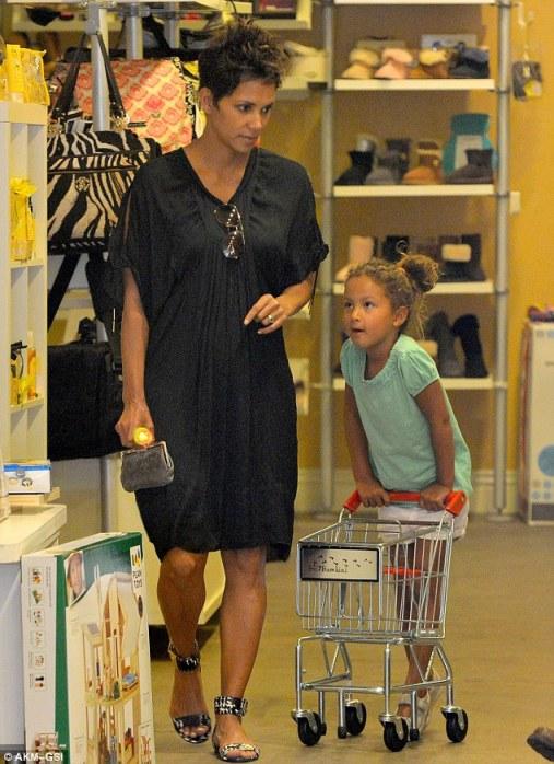Halle Berry flaunts baby bump in black dresses