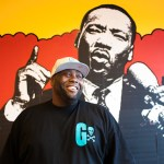 Killer Mike portraits in his barbershop graffiti swag shop