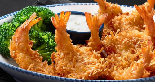 Fried shrimp on a plate with broccoli
