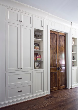 A custom coffee bar is built in behind cabinet doors, complete with pocket doors and a slide-out shelf.
