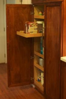 Each side of the custom pantry has five pull-out shelves mounted on full-extension drawer slides.