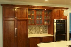 The hardware, glass and tile that the homeowner picked for this complement the kitchen wonderfully.