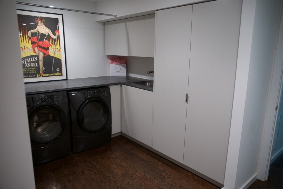 Laundry – Gloss white cabinetry.