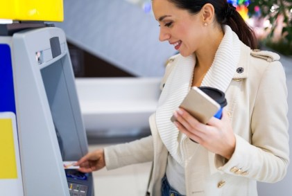 Happy Woman Using Smart ATM