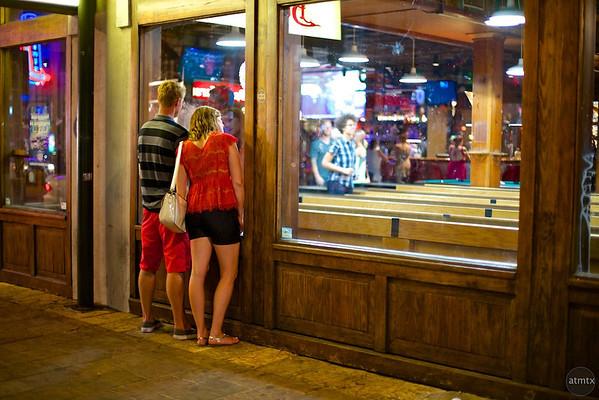A couple watches the action, Buffalo Billiards - Austin, Texas