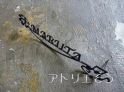 ロートアイアン風錆に強いステンレス製の八分音符+四葉のクローバー表札。