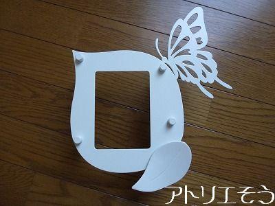 蝶インターホンカバー ロートアイアン風錆に強いステンレス製の葉に止まった蝶々のインターホンカバー