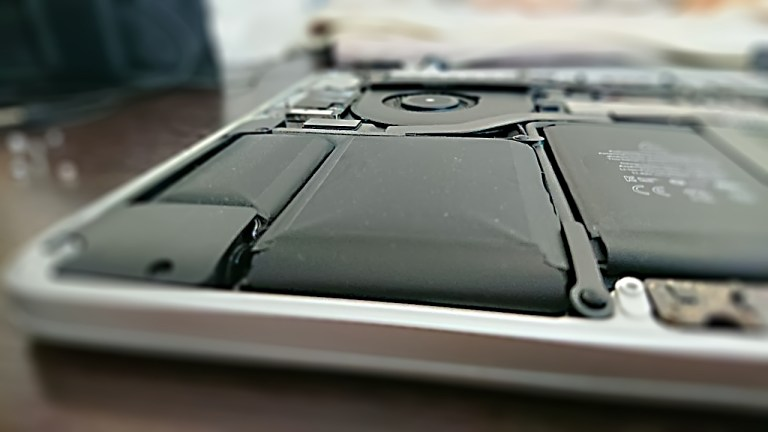 bloated MacBook battery cell