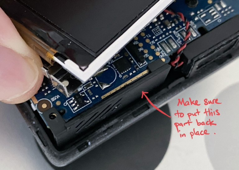 Placing the plastic part back in place