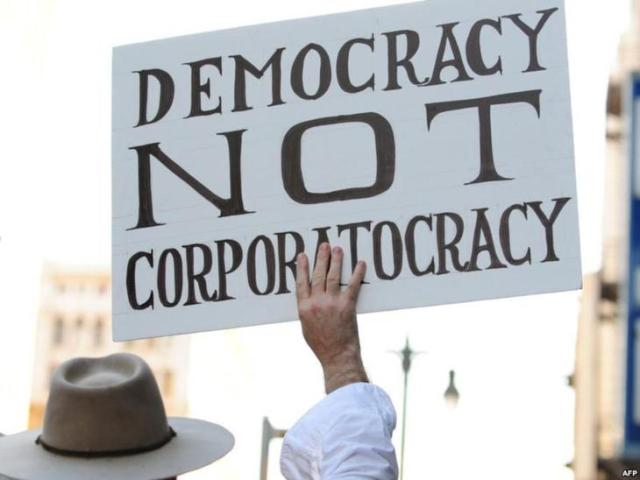 00-03a-democracy-not-corporatocracy