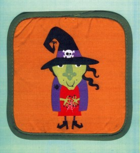This bigger witch has a crooked witch hat. What's missing here? Little witch's black cat!