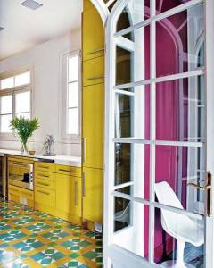Yellow Kitchen Cabinets Vivid yellow kitchen cabinets partner with a yellow  green and white  geometric cement tile floor