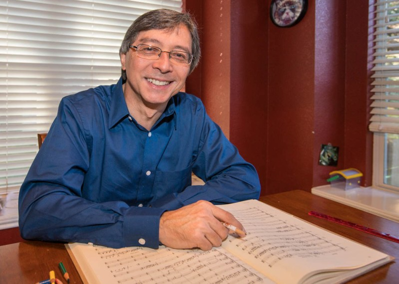 Austin Symphony Orchestra Conductor, Peter Bay, working on a score at home| ATX UnBound
