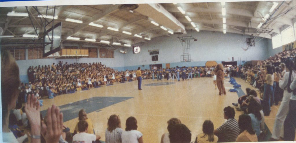 A pep rally packs the gym in 1981. Note the light blue wall colors.