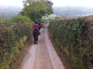 horse-riding-in-country-lane