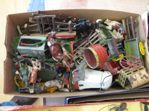 Lot 94 - A box of Britains people, farm animals, buildings - Sold for £40