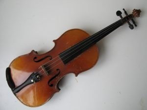 Violin 7/8 size scratches to varnish but no cracks or chips. No makers name. Resonates nicely. Recently restrung.