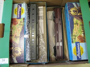 Lot 38 - Box of Athearn trains and carriages - Sold for £35