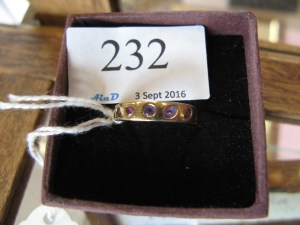 Lot 232 - Gold ring set with multi-coloured stones - Sold for £5