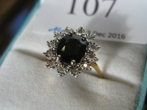 Lot 107 - Diamond and Sapphire Like Ring - Sold for £30