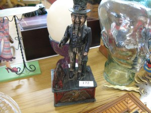 Lot 172 - Cast iron Uncle Sam money box - Sold for £35
