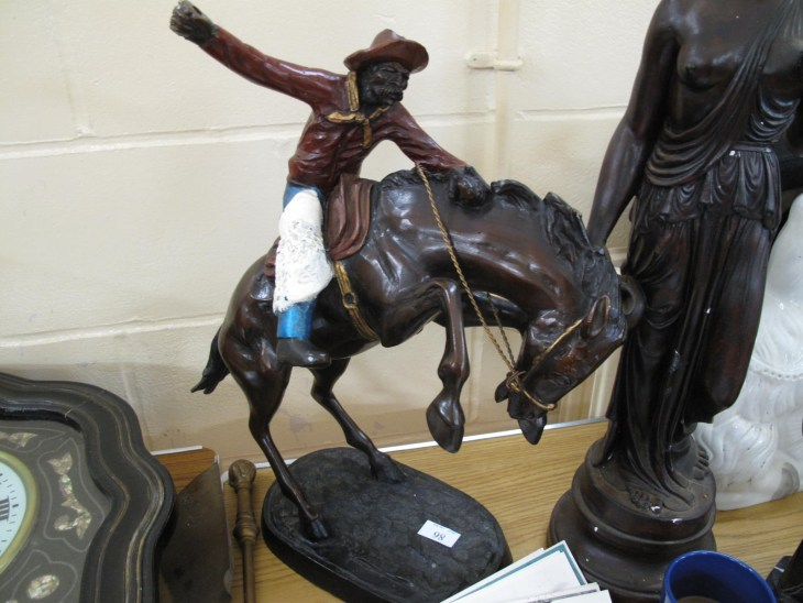Lot 89 - Bronze of rodeo cowboy on horse - Sold for £40