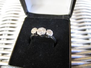 Lot 245 - White gold ring with three stones - Sold for £80