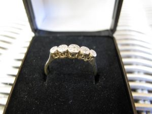 Lot 247 - Gold ring with five stones - Sold for £80