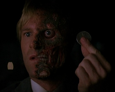 Batman and the Joker represent the two sides of Harvey Dent's two-faced coin .