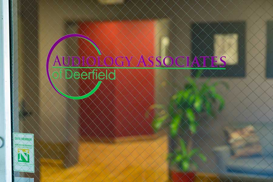 audiology associates of deerfield logo on glass door leading into office