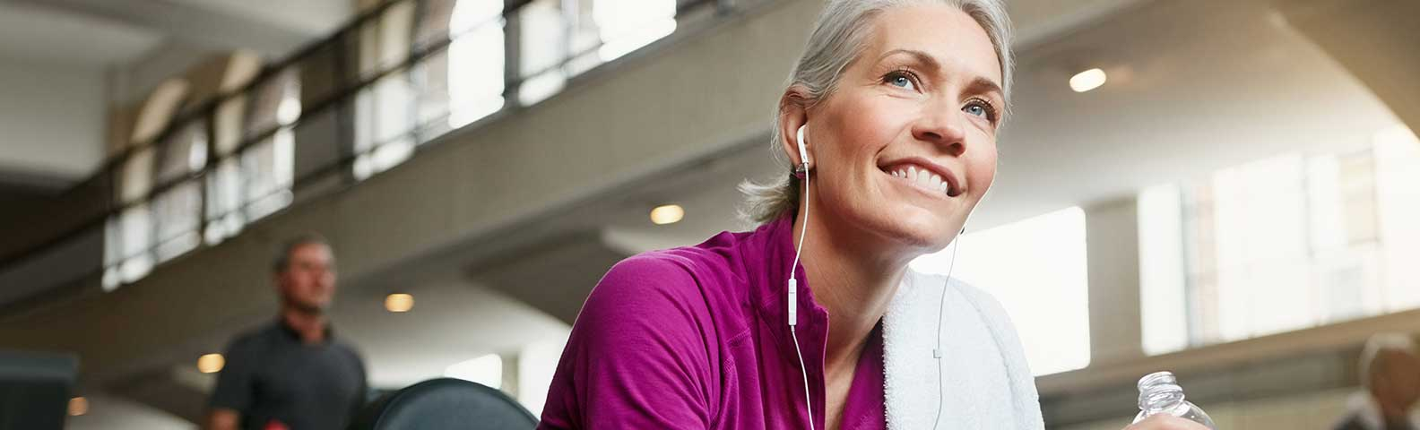 Woman working out to stay health to help prevent hearing loss