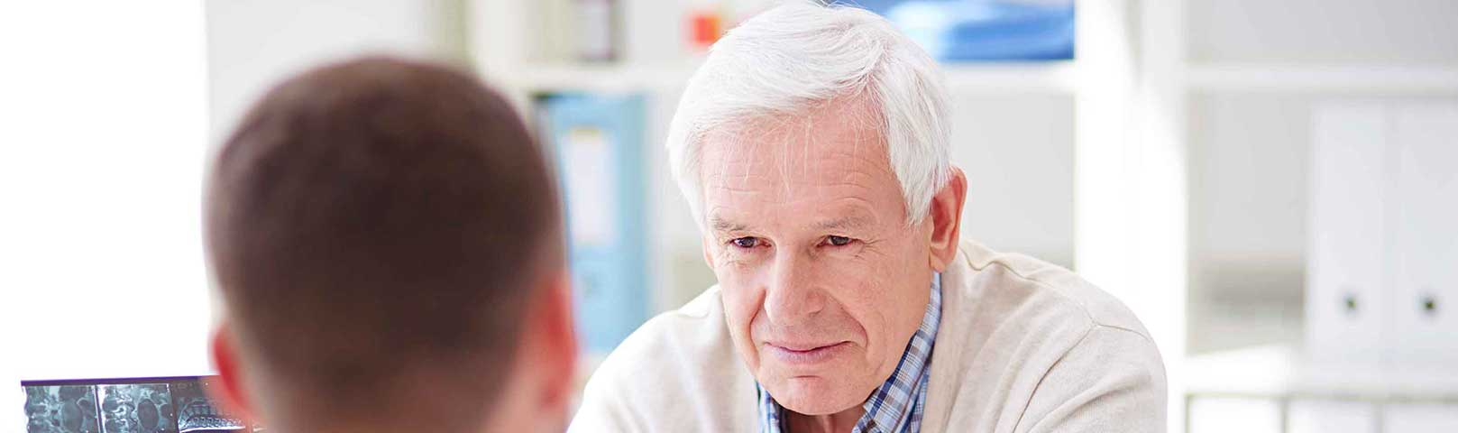 Audiologist talking to a patient about hearing loss