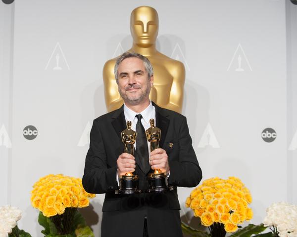 Alfonso Cuarón, con los premios Oscar al mejor director y montaje