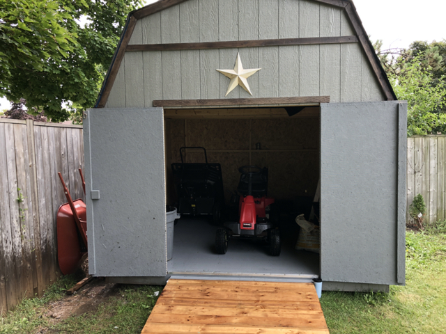 Large 10x10 barn style shed upgrade for a backyard makeover