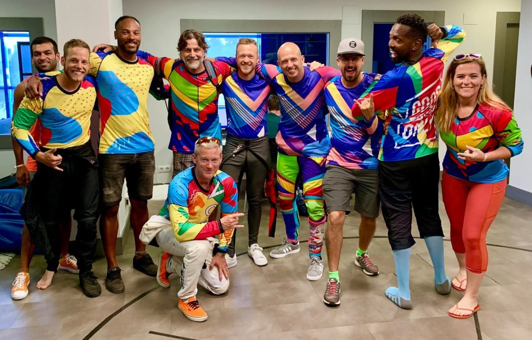 friends, skydivers, colorful jerseys