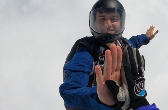 skydiving, high five, smile face clouds