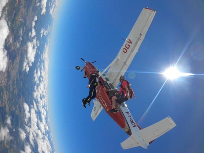 Skydivers exiting the plane in South Brazil during the FreeFlow.